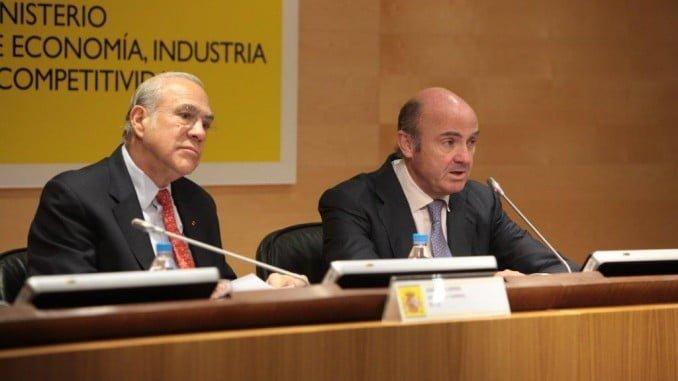 Luis de Guindos y Ángel Gurría en rueda de prensa