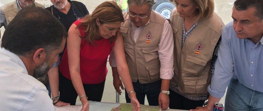 La presidenta de la Junta junto al ministro del Interior y la ministra de Empleo